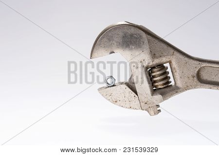 Old Monkey Wrench And Little Bolt Nut Isolated