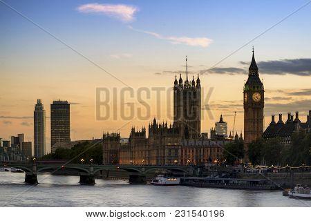 Beautiful London City Skyline Landscape At Night With Glowing City Lights And Iconic Landmark Buldin