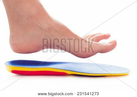 Orthopedic Insole And Female Leg Above It