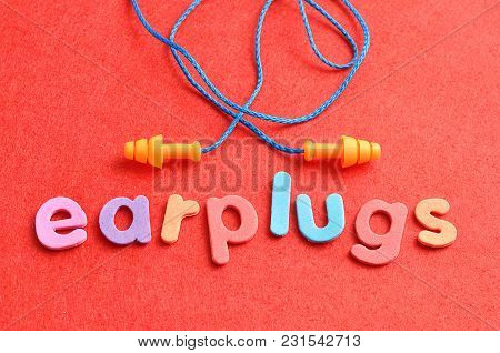 Earplugs With The Word Earplugs On A Red Background