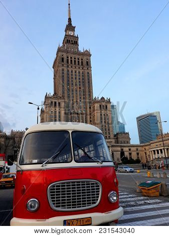 Warsaw, Poland - December 15, 2017: Retro Bus And The Palace Of Culture And Science, A Notable High-