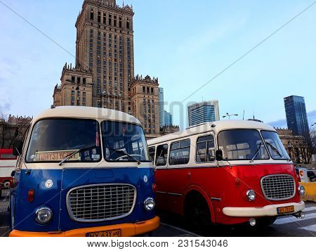 Warsaw, Poland - December 15, 2017: Retro Buses And The Palace Of Culture And Science, A Notable Hig