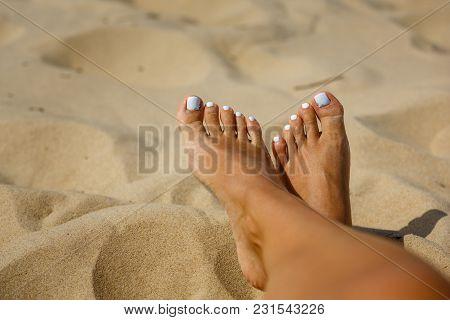 Woman's Legs On Sand