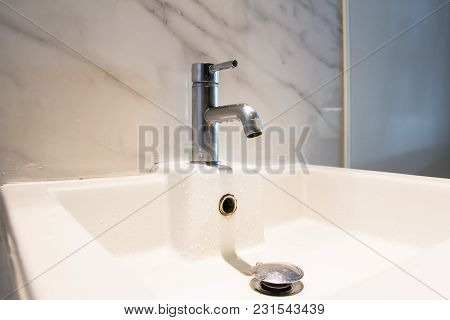 Close Up Modern Wash Basin In The Bathroom