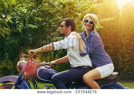 Beautiful Woman And Hansome Man On Retro Intage Motorbike. Couple In Love. Outdoor Shot With Ambient