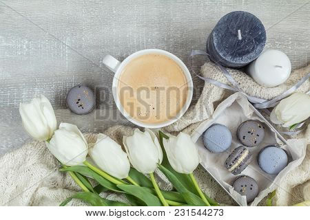 Cup Of Hot Coffee, Blue And Gray Macaroon, White Knitting Wool, White Tulip Flowers, Candles On Ligh