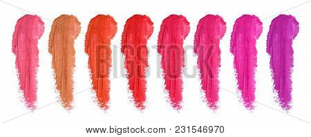 Set Of Lipstick Smudges Isolated On White Background. Smudged Makeup Product Sample.