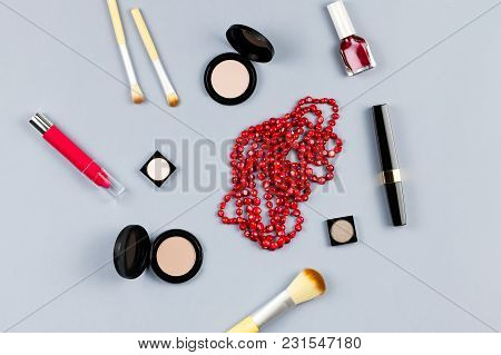 Woman Fashion Accessories, Jewelry And Cosmetics On Stylish Gray Background. Flat Lay, Top View
