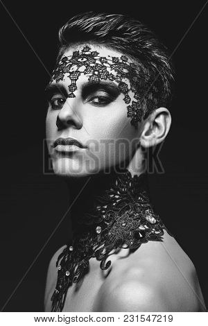 Handsome Young Man With Black Lace On Face. Studio Beauty Shot On Grey Background. Copy Space