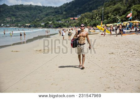Full Body Shot Of A Handsome Young Man Walking On A Beach In Phuket Island, Thailand, Shirtless Wear