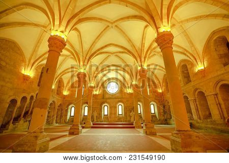 Alcobaca, Portugal - August 15, 2017: Three Vaulted Naves Divided By Two Rows Of Four Columns Inside