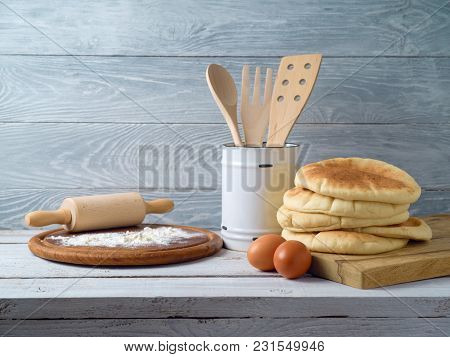 Freshlly Baked Pita Bread Over Kitchen Rustic Background