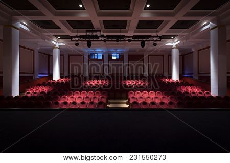 Concert hall of the theater with red new chairs. The interior of the hall in the theater or cinema v