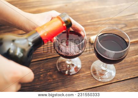 Hands Barmen Pour Red Wine In Two Glasses