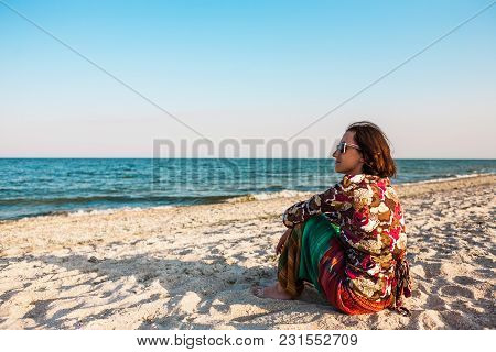 Girl On The Shore Of The Ocean.