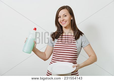 Young Housewife In Striped Apron Isolated On White Background. Housekeeper Woman Holds Bottle With C
