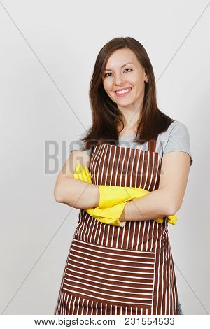 Young Smiling Brunette Caucasian Housewife In Striped Apron, Yellow Gloves Isolated On White Backgro