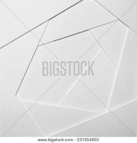 Abstract Geometric Background In Light Tones From Sheets Of Thick White Paper, Cardboard. Suitable A