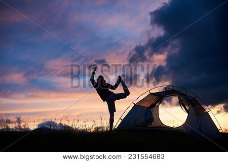 Silhouette Of A Woman Doing Yoga On Top Of A Mountain On Sunset Near The Tent Copyspace Harmony Bala