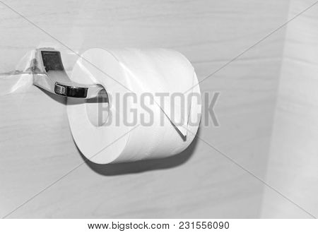 Roll Of Toilet Paper On The Holder. Close-up.
