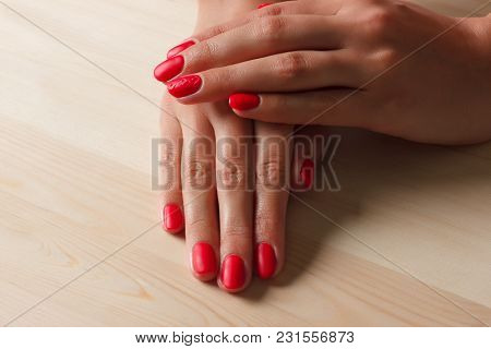 Hand With Nail Red Manicure On Wooden Substrate. Spa, Cosmetology, Long Fingers