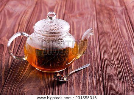 Hot Black Tea In Glass Tea Pot, Overhead On Wooden Table, Selective Focus