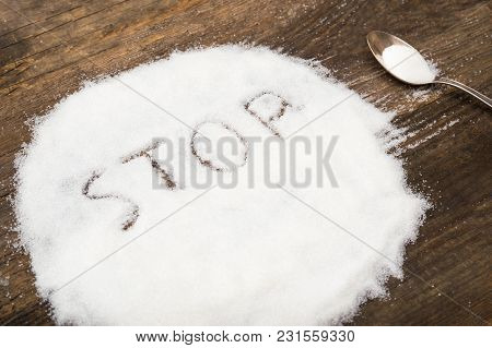 Stop Sign Made Of Granular Sugar. The Picture Illustrates The Harm Of Eating Sugar And Salt, As Well