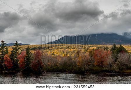 Fall Colors Blanket The Base Of Mount Katahdin Behind Penobscot River