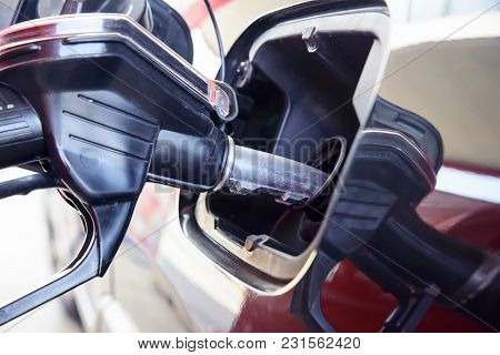 Refueling The Car With Gasoline Or Diesel Fuel, Refueling Gun In The Tank Close Up