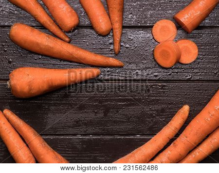 Carrots On Kitchen Table. Close-up. Isolated Macro