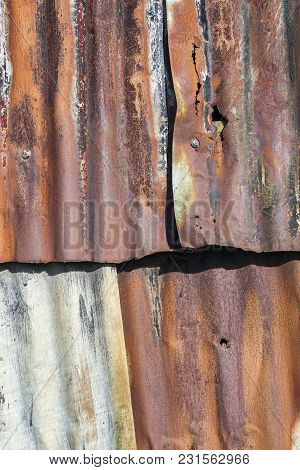 Distressed Old Corrugated Rust Covered Iron Fence Background