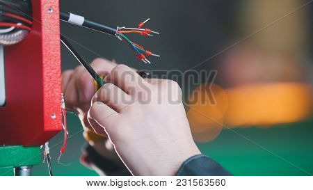 Electrician Installing Energy System On Machinery Industry, Close Up