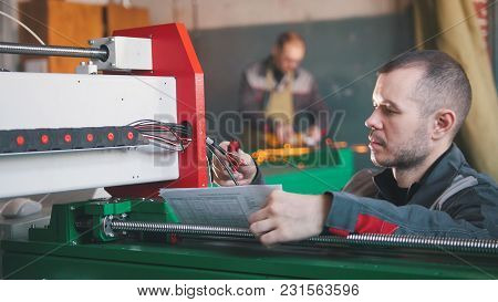 Hands Of Electrician Engineer Switching And Testing Equipment , Close Up