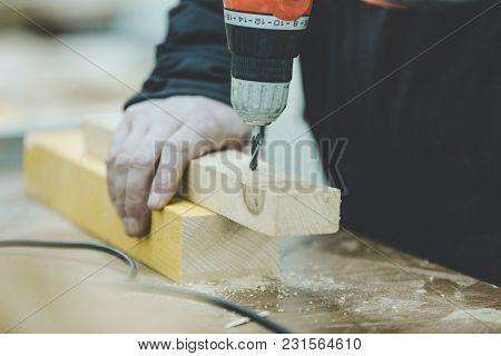 Senior Craftsman Working On Woodwork