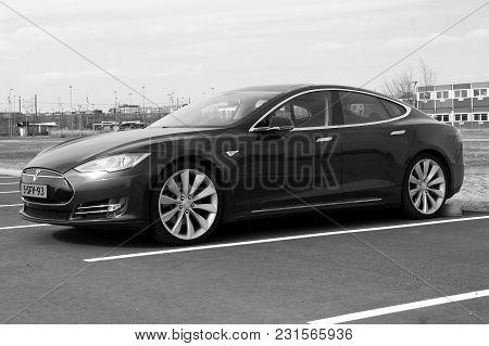 Almere, The Netherlands - March 17, 2018:  Electric Tesla Motors Model S Parked On A Parking Lot (bl