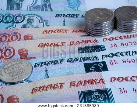 Russian Coins Lie On Several Banknotes Of The Bank Of Russia