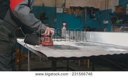 Manual Sander Sanding A Metal Detail At The Factory, Industrial Concept