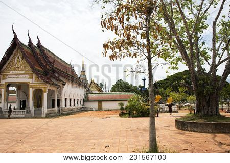 Three Buddha Brother Statue Beside Ubosot And Chedi Of Wat Phra Borommathat Chaiya Temple In Chaiya