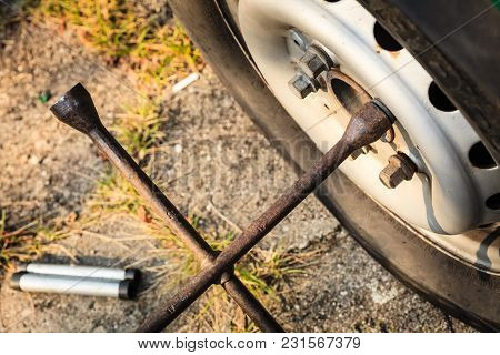 Mechanic Fixing, Changing And Repair Old Car Tire With Rim Socket Wrench
