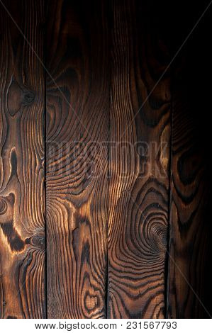 Burnt Pine Wooden Background, Boards Panel With Empty Space For Your Design.