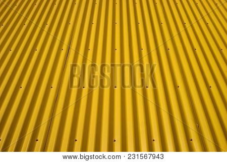 Yellow Corrugated Wall. Yellow Steel Background. Mounted With Screws. Can Be Used As A Background. T
