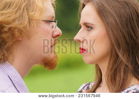 Serious Man And Woman Looking Into Each Other Eyes Having Bad Argue Fight. Confident People, Relatio