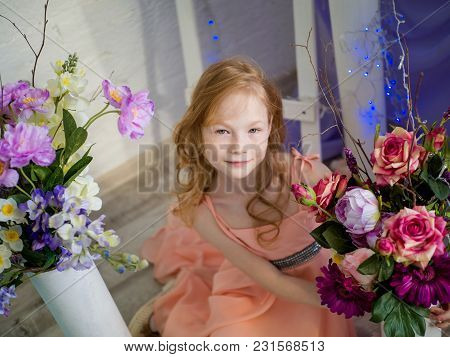Portrait Of A Red-haired Beautiful Girl With Freckles On Her Face With A Bouquet Of Spring Flowers I