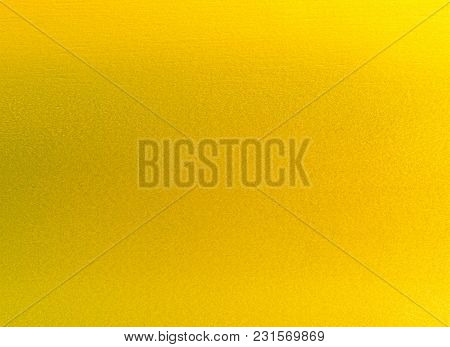 Shiny Yellow Leaf Gold Foil Texture Background.