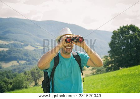 Tourist Handsome Man With Backpack Enjoying The View In Nature.