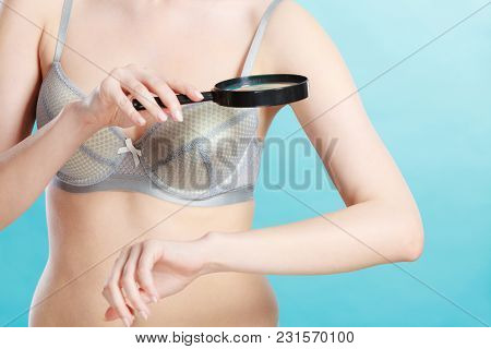 Skin Control Self Examination Concept. Yound Woman Holds Magnifying Glass In Hand Examining Her Body