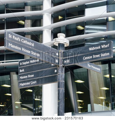 Signpost In The City Of London, England, Uk Pointing To Various Landmarks In Close Proximity