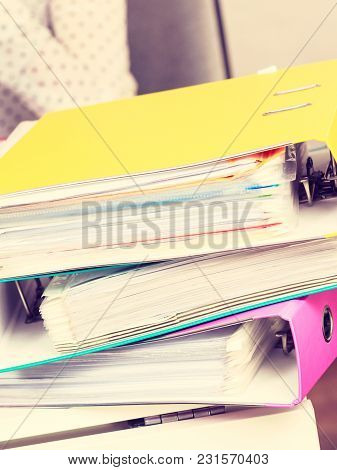 Many Colorful Binders With Documents And Paperwork Inside. Office Objects Details Concept.