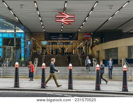 London, Uk- Mar 13, 2018: Entrance Of Cannon Street Station With City Workers. It Is Situated Within