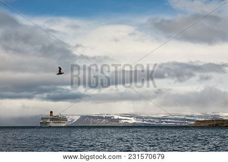 Cruise Ship Stopped In Front Of The Mountains In Isafjordur, Iceland